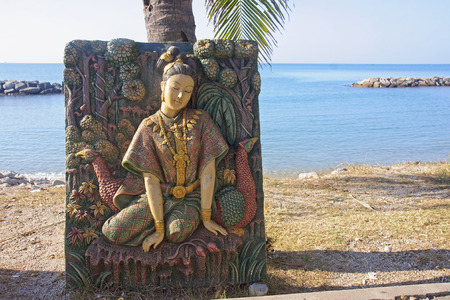 Bas-relief at the beach temple in Rayong - Thailand photo
