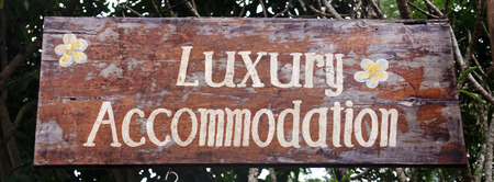 Old wooden plaque with the inscription Luxury Accommodation  Stock Photo