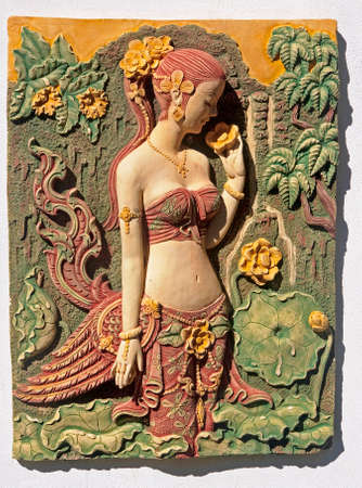 Bas-relief wall adorning the walls in Thailand