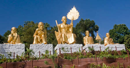 Golden statue of Buddhist monks in Thailand