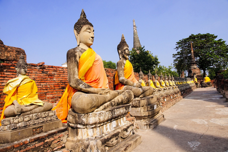 Buddha statues at Wat Yai Chai Mongkol in Ayutthaya - Thailand photo