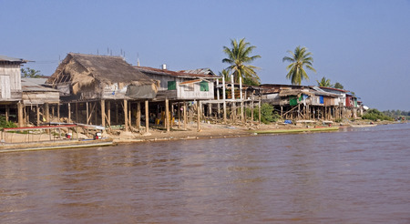 riverine: Cottages on the banks of the Mekong River in Laos