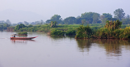 Boat on the Mekong River in the area of Don Det - Laos photo