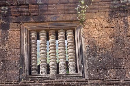 laotian: Window in Champasak Ruins - Laos