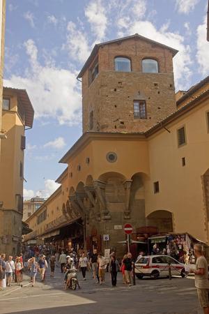 Tourists on Ponte Vecchio bridge in Florence Italy. Ponte Vecchio bridge is a bridge which sell their products goldsmiths