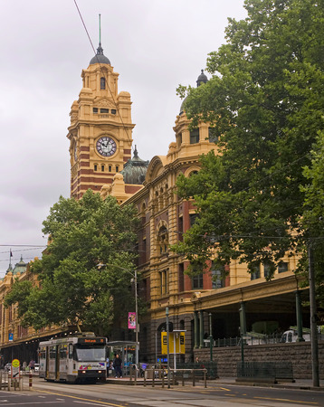 exiting: MELBOURNE, AUSTRALIA - JANUARY 15, 2015: Building the railway station in the city center on 15 January 2015 in Melbourne, Australia. The oldest railway station in Melbourne Editorial