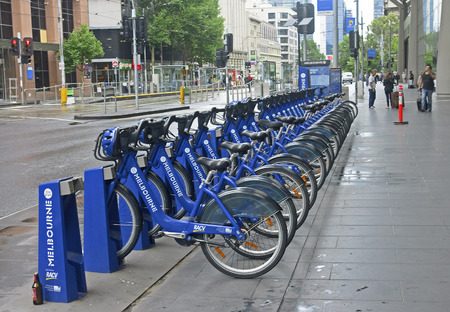 rented: MELBOURNE, AUSTRALIA - JANUARY 15, 2015: City bikes for rent on 15 January 2015 in Melbourne, Australia. City bikes are available for hire at many locations in Melbourne Editorial