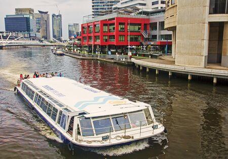 MELBOURNE, AUSTRALIA  - JANUAR 13, 2015: Yara River runs through the center of the city on 13 Januar 2015 in Melbourne, Australia. Yara River is a favorite place for  tours of boats Editöryel