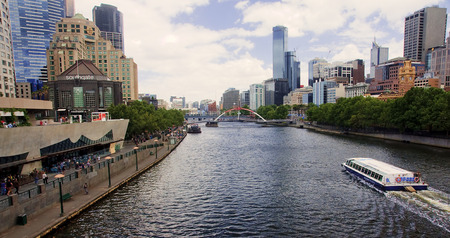 MELBOURNE, AUSTRALIA  - DECEMBER 30, 2014: Yara River runs through the center of the city on 30 December 2014 in Melbourne, Australia. Yara River is a favorite place for  tours of boats Editöryel
