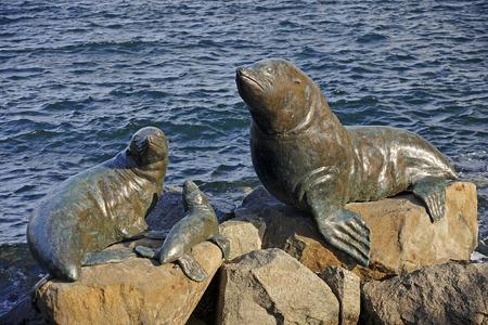 verdigris: Bronze statues located in the port of Hobart (Tasmania, Australia) Stock Photo
