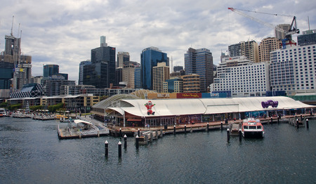 frequented: SYDNEY, AUSTRALIA - DECEMBER 11, 2014: Darling Harbour on 11 December 2014 in Sydney, Australia. Darling Harbour is a place frequented by tourists because there is a lot of interest