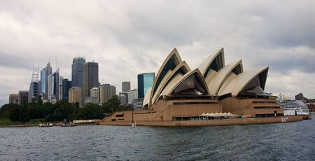 frequented: SYDNEY, AUSTRALIA - DECEMBER 2014: A view of the Sydney Opera House on December 2014 in Sydney, Australia. Sydney Opera House is a place known and frequented by tourists