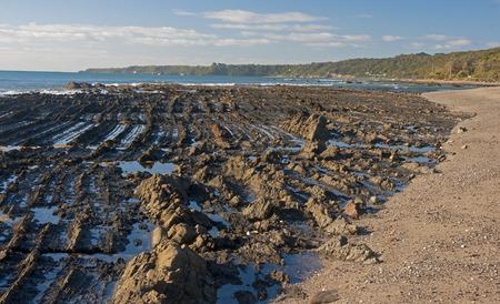 vicinity: Rocky beach in Australia in the vicinity of Melbourne Stock Photo