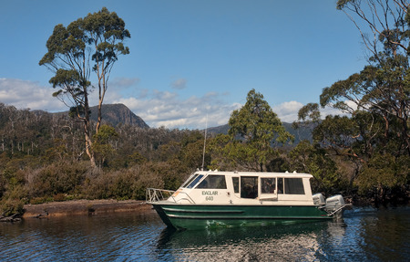 bushwalk: LAKE ST. CLAIR, AUSTRALIA  - JANUARY 10, 2015: Cruiser floating on Lake St. Clair on 10 January 2015 in Lake St. Clair, Australia. Lake St. Clair It is a popular tourist destination and lies at the end of the Overland Track Editorial