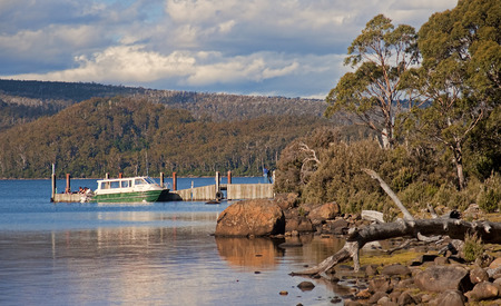 bushwalk: LAKE ST. CLAIR, AUSTRALIA - JANUARY 10, 2015: Cruiser floating on Lake St. Clair on 10 January 2015 in Lake St. Clair, Australia. Lake St. Clair It is a popular tourist destination and lies at the end of the Overland Track