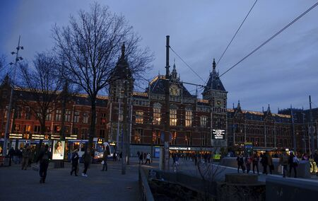 christmas train: AMSTERDAM, NETHERLANDS - DECEMBER 5, 2015: Railway station on 5 December 2015 in Amsterdam, Netherlands. During the Christmas train station is adorned with colorful lights. Editorial