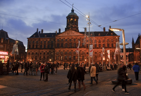 5 december: AMSTERDAM, NETHERLANDS - DECEMBER 5, 2015: Dam Square by night on 5 December 2015 in Amsterdam, Netherlands. Dam Square in Amsterdam is the main square of the city