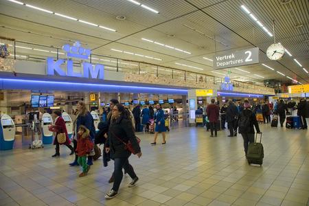 schiphol: AMSTERDAM, NETHERLANDS - DECEMBER 6, 2013: Interior of Amsterdam Airport Schiphol on December 6, 2013 in Amsterdam, Netherlands. Schiphol Airport is one of the largest in Europe Editorial