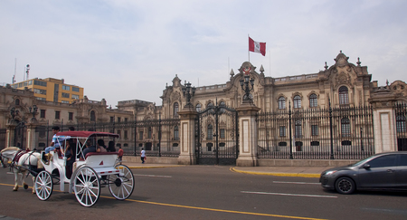 located: LIMA, PERU - DECEMBER 2, 2015: Government palace on 2 December 2015 in Lima, Peru. Government palace it located on the main square Plaza Mayor Editorial