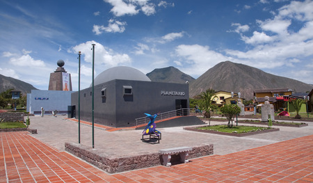 QUITO, ECUADOR - NOVEMBER 26, 2015:  Monument Mitad del Mundo on 26 November 2015 in Quito, Ecuador. This place is called the navel of the world situated exactly on the equator Editorial