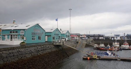 fishingboats: REYKJAVIK, ICELAND - SEPTEMBER 15, 2016: old harbour on 15 September 2016 in Reykjavik, Iceland. On the waterfront there are many restaurants and tourist agencies