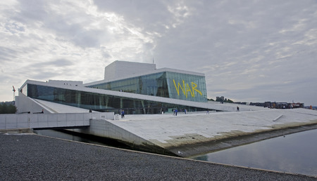 OSLO, NORWAY - SEPTEMBER 16, 2016: Oslo Opera house on 16 September 2016 in Oslo, Norway. Opera located in the Bjorvika district in the center of Oslo, at the beginning of the Oslofjord.