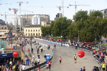 OSLO, NORWAY - SEPTEMBER 17, 2016:  Oslo Maraton on 17 September 2016 in Oslo, Norway. Run takes place through the streets of the city center and was attended by many runners Editorial