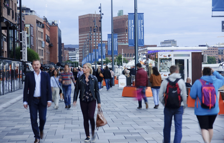 OSLO, NORWAY - SEPTEMBER 16, 2016: Aker Brygge in Oslo on 16 September 2016 in Oslo, Norway. It is a very popular place for walks in the city center