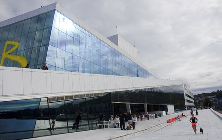 OSLO, NORWAY - SEPTEMBER 17, 2016: Oslo Opera house on 17 September 2016 in Oslo, Norway. Opera located in the Bjorvika district in the center of Oslo, at the beginning of the Oslofjord. Editorial