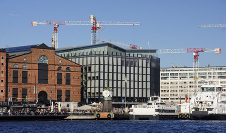 OSLO, NORWAY - SEPTEMBER 17, 2016: Aker Brygge in Oslo on 17 September 2016 in Oslo, Norway. It is a very popular place for walks in the city center