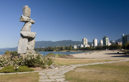 VANCOUVER, CANADA - AUGUST 24, 2016: Inukshuk landmark on 24 August 2016 in Vancouver, Canada. Inukshuk is a symbolic structure built by the Inuit man Editorial