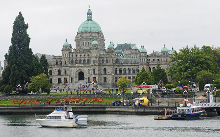 frequented: VICTORIA, CANADA - AUGUST 28, 2016: Legislative Assembly on 28 August 2016 in Vctoria, Canada. This is a view of downtown Victoria frequented by many tourists