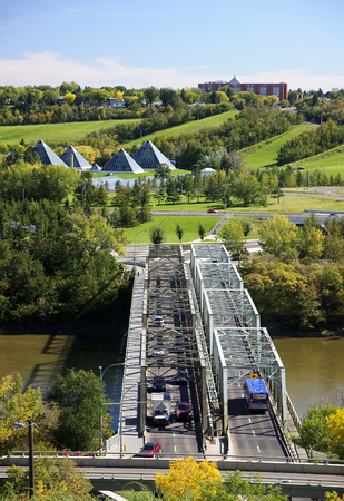EDMONTON, CANADA - SEPTEMBER 13, 2016: Bridge on the River on 13 September 2016 in Edmonton, Canada. In Edmonton there are many bridges connecting both banks of the Saskatchewan River