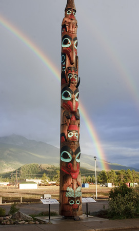 JASPER, CANADA - SEPTEMBER 8, 2016: Totem in the city center on 8 September 2016 in Jasper, Canada. Totems are often found in Canadian cities Editorial