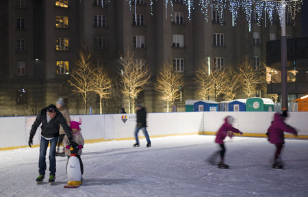 KATOWICE, POLAND - JANUARY 27, 2017: Ice rink in the city center on 27 January 2017 in Katowice, Poland. In the winter, the center is built ice rink frequented by locals Editorial