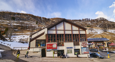 PEJO FONTI, ITALY - MARCH 7, 2017: Tourists in the center of the village on 7 March 2017 in Pejo Fonti, Italy. This village is a quiet alpine ski station in the Alps