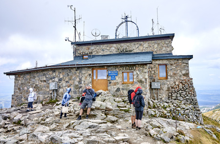 ropeway: ZAKOPANE, POLAND - SEPTEMBER 10, 2017: Meteorological observatory at the top of Kasprowy Wierch on 10 September 2017 in Zakopane, Poland. The observatory is located in the highest building in Poland