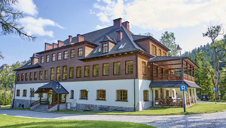 ZAKOPANE, POLAND - SEPTEMBER 10, 2017: Headquarters of the Tatra National Park on 10 September 2017 in Zakopane, Poland. In Kuznice there is a park and in its historic buildings the seat of the TPN