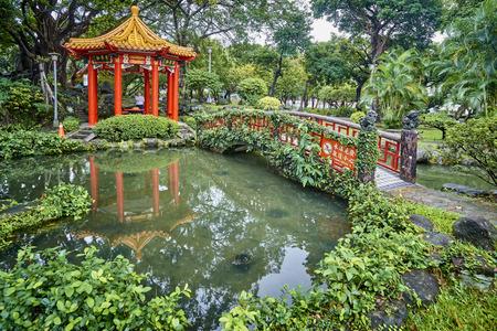 TAIPEI, TAIWAN - NOVEMBER 14, 2017: Gazebo in 228 memorial park on 14 November 2017 in Taipei, Taiwan. The park is located near the main railway station in the very center of the city. Editorial