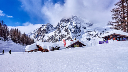 COURMAYEUR, ITALY - MARCH 7, 2018: Ski areas on 7 March 2018 in Courmayeur, Italy. It is one of the largest ski resorts in Europe under the Monte Bianco massif