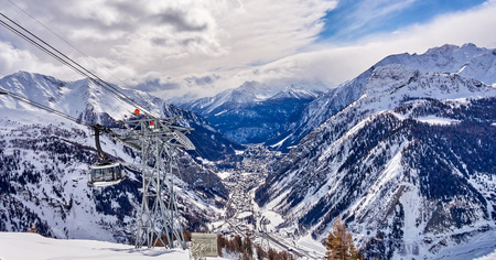 COURMAYEUR, ITALY - MARCH 7, 2018: The cable railway to Monte Bianco on 7 March 2018 in Courmayeur, Italy. The cable railway to Monte Bianco is a great attraction- the wagons rotate around 180 degrees Editorial