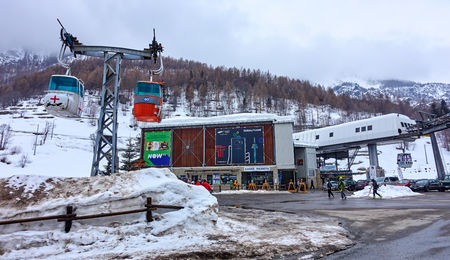 CERVINIA VALTOURNENCHE, ITALY - MARCH 5, 2018: It is a large ski station on the border with Switzerland on 5 March 2018 in Cervinia, Italy. The Italian ski area connects to the ski station in Zermatt