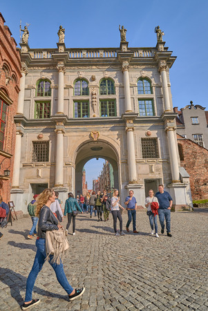 GDANSK, POLAND - APRIL 28, 2018: Famous Golden Gate on 28 April 2018 in Gdansk, Poland. Was erected in 1612 on the site of a fourteenth-century gothic gate
