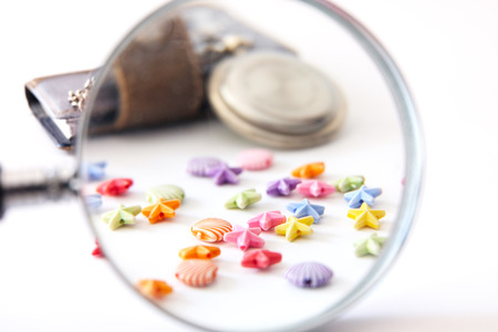 magnifier old clock notebook with multi-colored beads