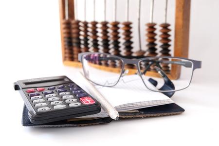 calculator glasses pencils white background