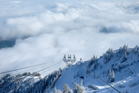 cable car: Towards the Stanserhorn on Cabrio cable car in cloudy day. Stock Photo