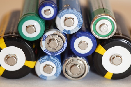 Concept background of colorful batteries in a stack photo