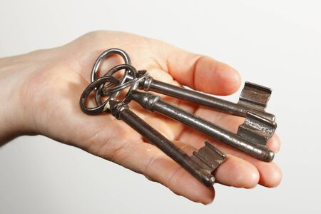 keyhole in hand with three old keys Stock Photo - 9636681