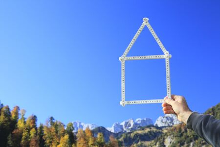 house dreams in hand on nature background photo