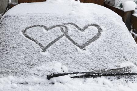 two hearts on car  windscreen in winter